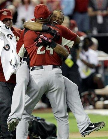 Jose Cano hugs his son American League's Robinson Cano of the New York Yankees after winning the MLB Home Run Derby Monday, July 11, 2011, in Phoenix. (AP Photo/David J. Phillip) By David J. Phillip