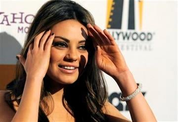 Actress Mila Kunis poses for photographers at the 14th Annual Hollywood Awards Gala in Beverly Hills, Calif., Monday, Oct. 25, 2010. (AP Photo/Chris Pizzello) By Chris Pizzello