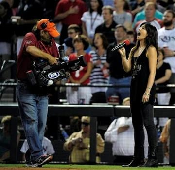 """Michelle Branch sings """"God Bless America"""" during the seventh inning stretch of the MLB All-Star baseball game Tuesday, July 12, 2011, in Phoenix. (AP Photo/Mark J. Terrill) By Mark J. Terrill"""