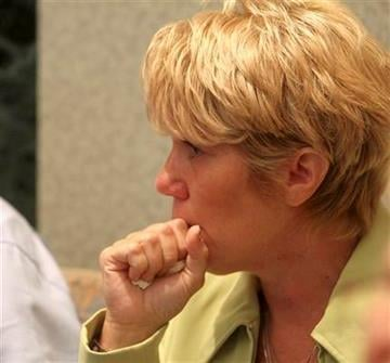 Cindy Anthony waits in the courtroom after an announcement that there is a verdict in the murder trial of her daughter, Casey Anthony, at the Orange County Courthouse in Orlando, Fla., Tuesday,  July 5, 2011.  (AP Photo/Red Huber, Pool) By Red Huber