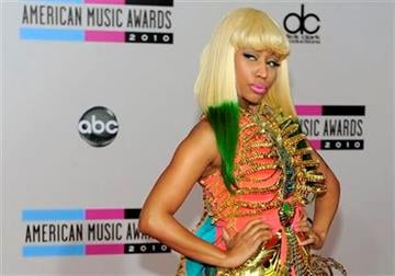 Nicki Minaj arrives at the 38th Annual American Music Awards on Sunday, Nov. 21, 2010 in Los Angeles. (AP Photo/Chris Pizzello) By Chris Pizzello