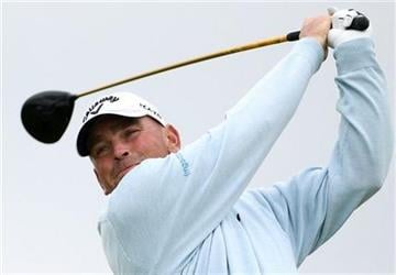 Denmark's Thomas Bjorn plays a shot off the 17th tee during the first day of the British Open Golf Championship at Royal St George's golf course Sandwich, England, Thursday, July 14, 2011. (AP Photo/Tim Hales) By Tim Hales