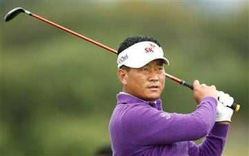 Korea's KJ Choi plays a shot on the 4th fairway during the first day of the British Open Golf Championship at Royal St George's golf course Sandwich, England, Thursday, July 14, 2011. (AP Photo/Jon Super) By Jon Super