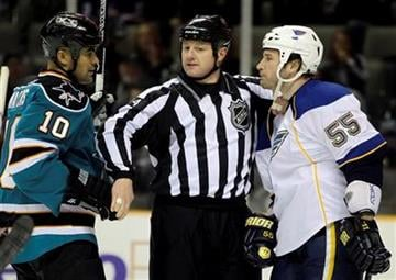 A referee breaks up a fight between St. Louis Blues' Cam Janssen (55) and San Jose Sharks' Jamal Mayers (10) during the first period of an NHL hockey game Saturday, March 19, 2011, in San Jose, Calif. (AP Photo/Ben Margot) By Ben Margot