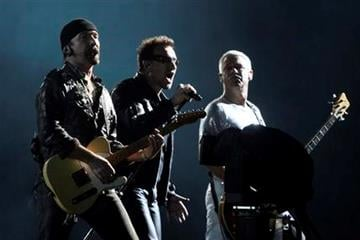 Members of the Irish rock band U2, Bono, center, Adam Clayton, right, and The Edge perform in concert during their 360 world tour at the Azteca stadium in Mexico City, Wednesday, May 11, 2011. (AP Photo/Alexandre Meneghini) By Alexandre Meneghini