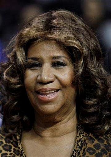 Aretha Franklin smiles after the Detroit Pistons-Miami Heat NBA basketball game in Auburn Hills, Mich., Friday, Feb. 11, 2011. (AP Photo/Paul Sancya) By Paul Sancya