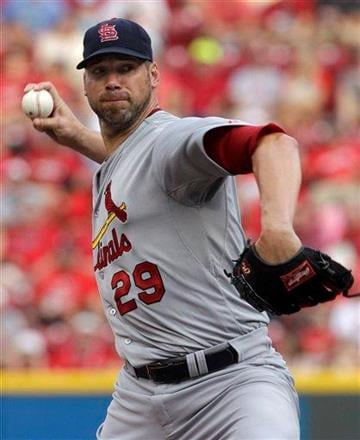St. Louis Cardinals starting pitcher Chris Carpenter throws against the Cincinnati Reds in the first inning of a baseball game, Saturday, July 16, 2011, in Cincinnati. (AP Photo/Al Behrman) By Al Behrman