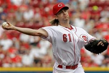 Cincinnati Reds starting pitcher Bronson Arroyo throws against the St. Louis Cardinals during the first inning of a baseball game, Saturday, July 16, 2011, in Cincinnati. (AP Photo/Al Behrman) By Al Behrman