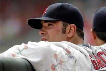 St. Louis Cardinals starting pitcher Jaime Garcia wacthes from the dugout during the eighth inning of a baseball game against the Cincinnati Reds, Sunday, July 17, 2011, in Cincinnati. Cincinnati won 3-1. (AP Photo/Al Behrman) By Al Behrman