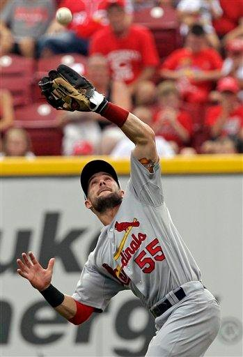 St. Louis Cardinals second baseman Skip Schumaker catches a fly ball hit by Cincinnati Reds' Zack Cozart during the first inning of a baseball game, Sunday, July 17, 2011, in Cincinnati. (AP Photo/Al Behrman) By Al Behrman