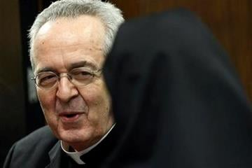 Cardinal Justin Rigali meets with a nun after a news conference Tuesday, July 19, 2011, in Philadelphia.  The Vatican on Tuesday named Chaput as Rigali's successor as Archbishop of Philadelphia. (AP Photo/Matt Rourke) By Matt Rourke