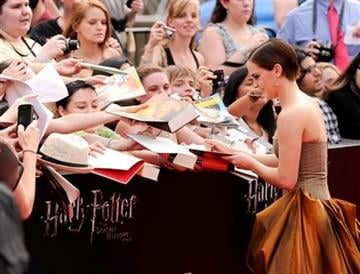 "Actress Emma Watson attends the premiere of ""Harry Potter and the Deathly Hallows: Part 2"" at Avery Fisher Hall on Monday, July 11, 2011 in New York. (AP Photo/Evan Agostini) By Evan Agostini"