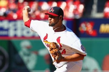 ST. LOUIS, MO - AUGUST 11: Reliever Edward Mujica #44 of the St. Louis Cardinals pitches against the Chicago Cubs at Busch Stadium on August 11, 2013 in St. Louis, Missouri.  (Photo by Dilip Vishwanat/Getty Images) By Dilip Vishwanat