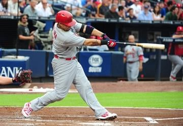 ATLANTA, GA - JULY 26: Yadier Molina #4 of the St. Louis Cardinals hits a second inning home run against the Atlanta Braves at Turner Field on July 26, 2013 in Atlanta, Georgia. (Photo by Scott Cunningham/Getty Images) By Scott Cunningham