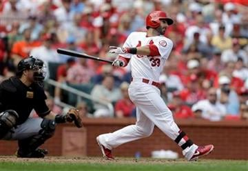 St. Louis Cardinals' Daniel Descalso follows through on a two-run single as Pittsburgh Pirates catcher Russell Martin watches during the fifth inning of a baseball game Thursday, Aug. 15, 2013, in St. Louis. (AP Photo/Jeff Roberson) By Jeff Roberson