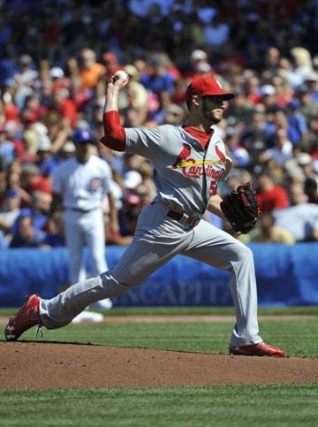 CHICAGO, IL - AUGUST 17: Joe Kelly #58 of the St. Louis Cardinals pitches against the Chicago Cubs during the first inning on August 17, 2013 at Wrigley Field in Chicago, Illinois.  (Photo by David Banks/Getty Images) By David Banks