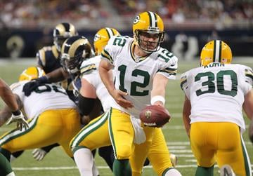 Green Bay Packers quarterback Aaron Rodgers hands the football off in the first quarter against the St. Louis Rams in their pre season game at the Edward Jones Dome in St. Louis on August 17, 2013.   UPI/Bill Greenblatt By BILL GREENBLATT