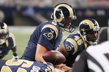 St. Louis Rams quarterback Sam Bradford mishandles the football on the one yardline of the Green Bay Packers in the first quarter of their pre season game at the Edward Jones Dome in St. Louis on August 17, 2013.   UPI/Bill Greenblatt By BILL GREENBLATT