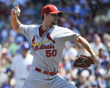 CHICAGO, IL - AUGUST 18: Adam Wainwright #50 of the St. Louis Cardinals pitches against the Chicago Cubs during the first inning  on August 18, 2013 at Wrigley Field in Chicago, Illinois.  (Photo by David Banks/Getty Images) By David Banks
