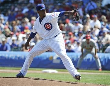 CHICAGO, IL - AUGUST 18: Edwin Jackson #36 of the Chicago Cubs pitches against the St. Louis Cardinals during the first inning on August 18, 2013 at Wrigley Field in Chicago, Illinois.  (Photo by David Banks/Getty Images) By David Banks