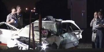 Police officers examine the scene of an accident in Fresno, Calif., on Monday, August 19, 2013
