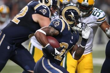 St. Louis Rams running back Isaiah Pead runs the football past the Green Bay Packers defense in the first quarter of their pre season game at the Edward Jones Dome in St. Louis on August 17, 2013.   UPI/Bill Greenblatt By BILL GREENBLATT