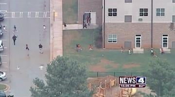 Teen surrenders after gunfire at GA. school.  A 19-year-old armed with an assault rifle enters an elementary school and trades shots with officers. Eight-hundred students escape unharmed. By KMOV Web Producer