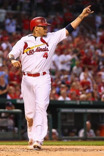 ST. LOUIS, MO - AUGUST 23:  Yadier Molina #4 of the St. Louis Cardinals scores a run against the Atlanta Braves  in the second inning at Busch Stadium on August 23, 2013 in St. Louis, Missouri.  (Photo by Dilip Vishwanat/Getty Images) By Dilip Vishwanat
