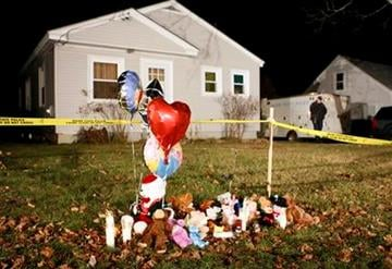 A memorial grows outside the home of missing 20-month-old Ayla Reynolds, Thursday, Dec. 22, 2011, in Waterville, Maine. Investigators put up crime scene tape around the house on Thursday. (AP Photo/Robert F. Bukaty) By Robert F. Bukaty