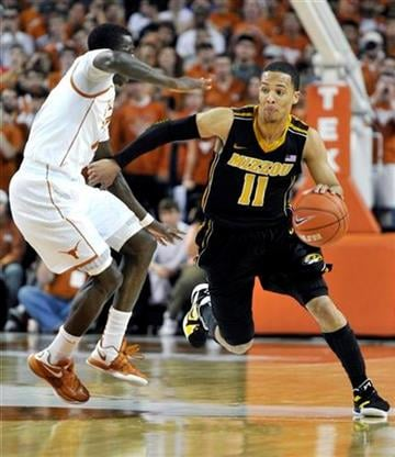 Missouri guard Michael Dixon, Jr. (11) drives around Texas guard Myck Kabongo during the first half of an NCAA college basketball game, Monday, Jan. 30, 2012, in Austin, Texas. (AP Photo/Michael Thomas) By Michael Thomas