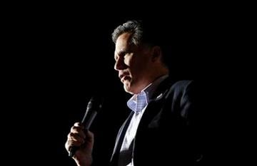 """Republican presidential candidate, former Massachusetts Gov. Mitt Romney, sings """"America the Beautiful"""" as he campaigns at Lake Sumter Landing, The Villages, Fla., Monday, Jan. 30, 2012. (AP Photo/Charles Dharapak) By Charles Dharapak"""