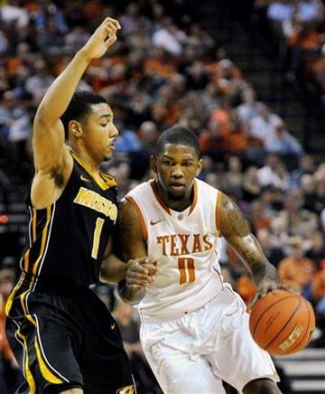 Texas guard Julien Lewis (0) drives past Missouri guard Phil Pressey (1) during the first half of an NCAA college basketball game, Monday, Jan. 30, 2012, in Austin, Texas. (AP Photo/Michael Thomas) By Michael Thomas