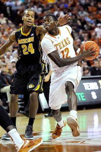 Texas guard Myck Kabongo (12) drives around Missouri guard Kim English (24) during the first half of an NCAA college basketball game, Monday, Jan. 30, 2012, in Austin, Texas. (AP Photo/Michael Thomas) By Michael Thomas