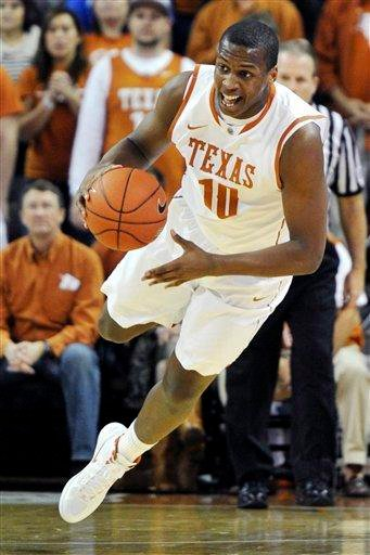 Texas forward Jonathan Holmes dives for the loose ball against Missouri during the first half of an NCAA college basketball game, Monday, Jan. 30, 2012, in Austin, Texas. (AP Photo/Michael Thomas) By Michael Thomas