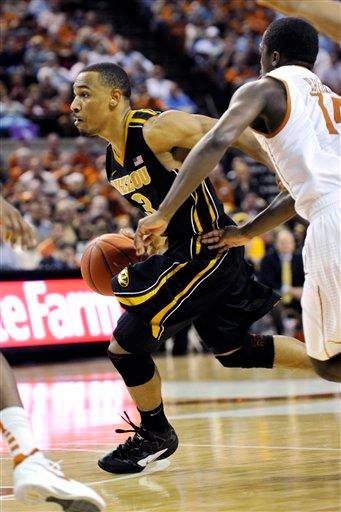 Missouri guard Matt Pressey (3) goes to the basket against Texas guard J'Covan Brown (14) during the first half of an NCAA college basketball game, Monday, Jan. 30, 2012, in Austin, Texas. (AP Photo/Michael Thomas) By Michael Thomas