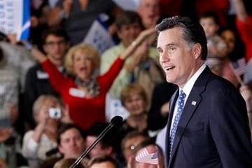 Republican presidential candidate, former Massachusetts Gov. Mitt Romney, celebrates his Florida primary election win at the Tampa Convention Center in Tampa, Fla., Tuesday, Jan. 31, 2012. (AP Photo/Charles Dharapak) By Charles Dharapak