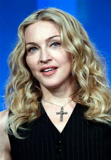 Madonna arrives for a news conference for NFL footbal's Super Bowl XLVI's halftime show Thursday, Feb. 2, 2012, in Indianapolis. (AP Photo/Morry Gash) By Morry Gash