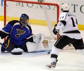 St. Louis Blues' goalie Jaroslav Halak, left, of Slovakia, blocks a shot by Los Angeles Kings' Justin Williams (14) in the third period of an NHL hockey game on Friday, Feb. 3, 2012, in St. Louis. The Blues won 1-0. (AP Photo/Bill Boyce) By Bill Boyce
