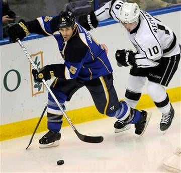 St. Louis Blues' Barret Jackman (5) gets around Los Angeles Kings' Mike Richards (10) in the second period of an NHL hockey game on Friday, Feb. 3, 2012, in St. Louis. (AP Photo/Bill Boyce) By Bill Boyce
