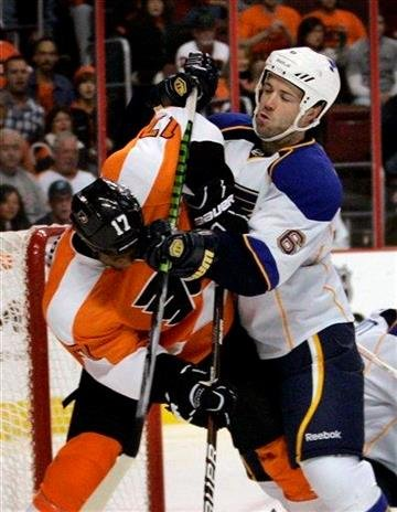 Philadelphia Flyers' Wayne Simmonds, left, is shoved by Saint Louis Blues' Kent Huskins during the second period of an NHL hockey game, Saturday, Oct. 22, 2011, in Philadelphia. The Blues won 4-2. (AP Photo/Tom Mihalek) By Tom Mihalek