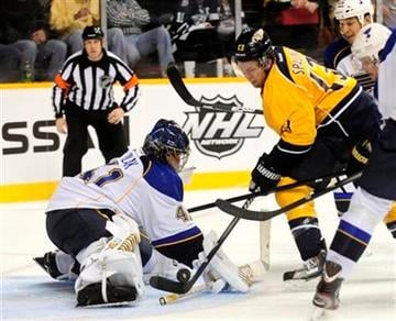 St. Louis Blues goalie Jaroslav Halak (41), of Slovakia, stops a shot by Nashville Predators center Nick Spaling (13) in the second period of an NHL hockey game on Saturday, Feb. 4, 2012, in Nashville, Tenn. (AP Photo/Mike Strasinger) By Mike Strasinger