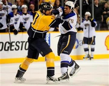 Nashville Predators forward Brian McGrattan (23) and St. Louis Blues right wing Ryan Reaves (75) fight during the second period of an NHL hockey game on Saturday, Feb. 4, 2012, in Nashville, Tenn. (AP Photo/Mike Strasinger) By Mike Strasinger