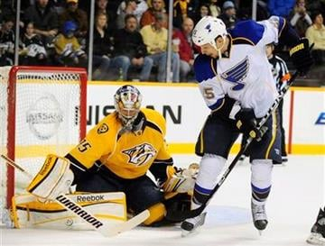 Nashville Predators goalie Pekka Rinne (35), of Finland, stops a shot by St. Louis Blues right wing Chris Stewart (25) in the first period of an NHL hockey game on Saturday, Feb. 4, 2012, in Nashville, Tenn. (AP Photo/Mike Strasinger) By Mike Strasinger