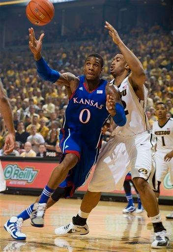 Kansas' Thomas Robinson, left, loses control of the ball as Missouri's Steve Moore, right, defends during the first half of an NCAA college basketball game on Saturday, Feb. 4, 2012, in Columbia, Mo. (AP Photo/L.G. Patterson) By L.G. PATTERSON