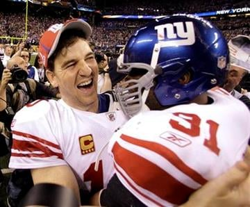New York Giants quarterback Eli Manning, left, and Justin Tuck celebrate their team's 21-17 win over the New England Patriots in the NFL Super Bowl XLVI football game, Sunday, Feb. 5, 2012, in Indianapolis. (AP Photo/Eric Gay) By Eric Gay