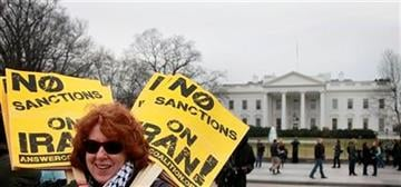 Melba Conway, an activist with the ANSWER Coalition, holds a stack of signs during a demonstration outside of the White House, Saturday, Feb. 4, 2012, in Washington. (AP Photo/Haraz N. Ghanbari) By Haraz N. Ghanbari