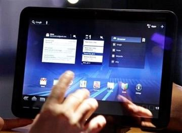 A buyer tests out Motorola's Xoom tablet at the International Consumer Electronics Show, Saturday, Jan. 8, 2011 in Las Vegas. (AP Photo/Julie Jacobson) By Julie Jacobson