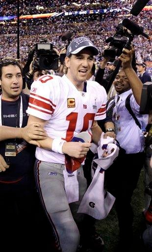 New York Giants quarterback Eli Manning, center, celebrates his team's 21-17 win against New England Patriots after the NFL Super Bowl XLVI football game, Sunday, Feb. 5, 2012, in Indianapolis. (AP Photo/Marcio Jose Sanchez) By Marcio Jose Sanchez