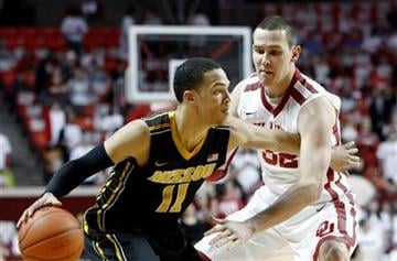Missouri's Michael Dixon (11) goes to the basket as Oklahoma's Casey Arent (32) defends during the first half of an NCAA college basketball game in Norman, Okla. on Monday, Feb. 6, 2012.  (AP Photo/Alonzo Adams) By Alonzo Adams