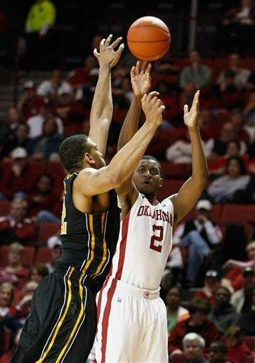 Oklahoma guard Steven Pledger (2) goes up for a shot as a Missouri player defends during the second half of an NCAA college basketball game in Norman, Okla. on Monday, Feb. 6, 2012.  Missouri won 71-68.  (AP Photo/Alonzo Adams) By Alonzo Adams